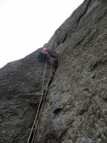Myself leading the 1st pitch of the Troach (E2, 5b) at Cloggy, North Wales